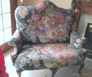 Upholstered claw foot loveseat